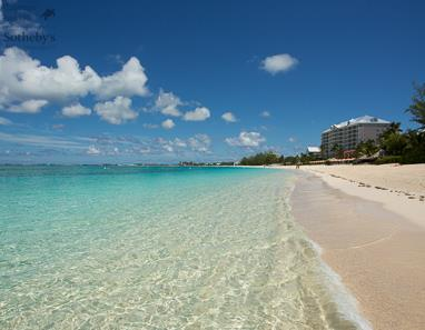 View across Seven Mile Beach to Caribbean Sea in front of The Cayman Club