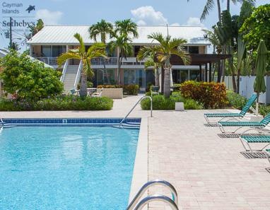 View across swimming pool to condos at Island Pine Villas
