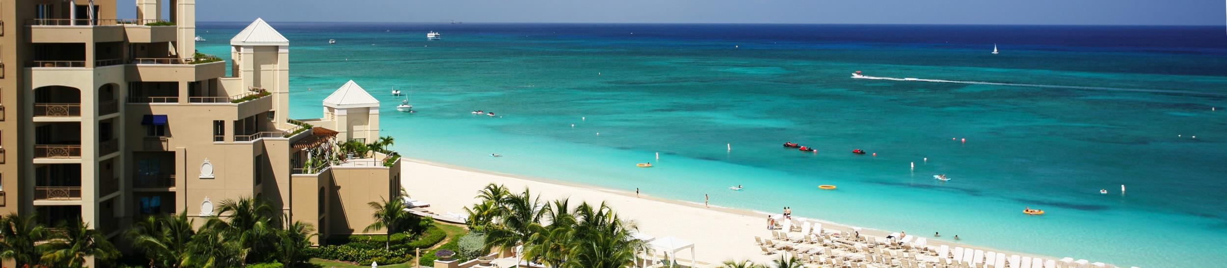 A view from the North Tower at The Ritz-Carlton Grand Cayman looking south across pool and Seven Mile Beach