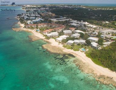 Aerial view from over Caribbean Sea of Seven Mile Beach and Cocoplum