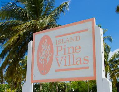 Sign board which reads: Island Pine Villas