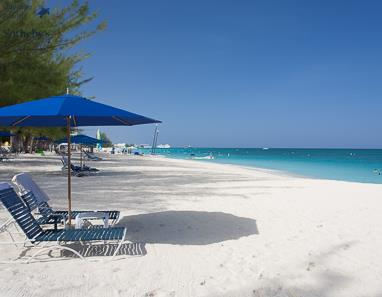 Sunbeds on Seven Mile Beach in front of Villas of the Galleon, Grand Cayman