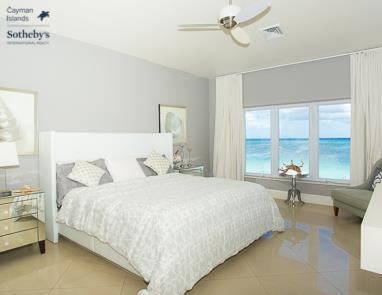 Bedroom at Laguna Del Mar overlooking Seven Mile Beach and Caribbean Sea