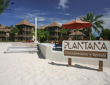 Sign on the beach at Plantana reads: Plantana Condominiums Rentals