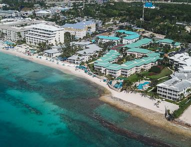 Aerial view of Plantation Village Beach Resort taken from above Caribbean Sea looking north east