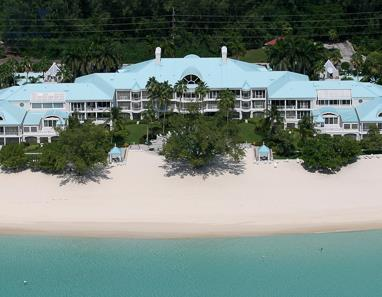 Aerial view from over Caribbean Sea of Seven Mile Beach and The Great House