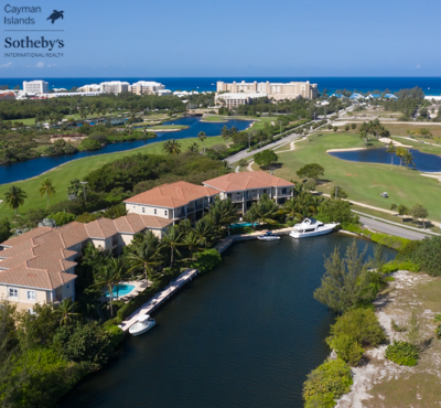 Turnberry Villas aerial view from above Safe Haven canal looking towards the Ritz-Carlton Grand Cayman and Seven Mile Beach