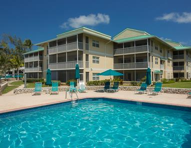 View across swimming pool to Plantation Village condos