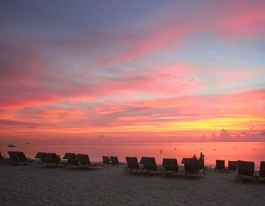 Sunset taken from Seven Mile Beach across Caribbean Sea at The Ritz-Carlton Grand Cayman