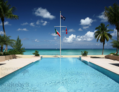 View across swimming pool at the Caribbean Club towards Seven Mile Beach and the Caribbean Sea